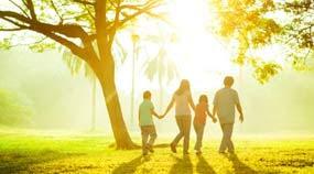 Photo: A family walking outside
