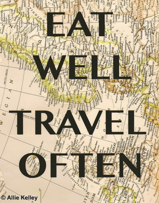 """ eat well travel often"" - text printed on a map"