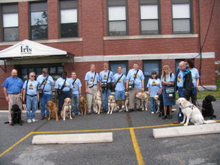 The dog owners in front of the Iris Center