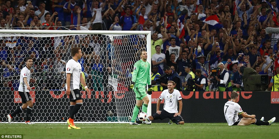The German defence cannot believe they've conceded a second goal as Griezmann wheels away to celebrate with his team-mates