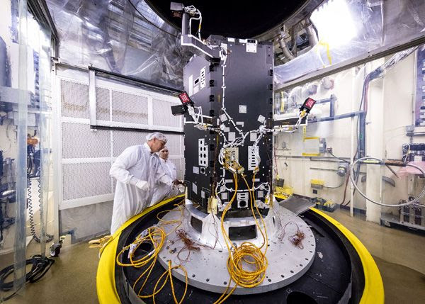 At the Johns Hopkins University Applied Physics Laboratory in Laurel, Maryland, technicians prepare the Solar Probe Plus spacecraft—which is still undergoing construction—for thermal vacuum tests that simulate conditions in space.