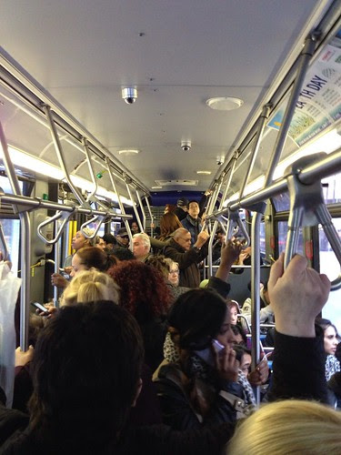 On a crowded crosstown bus