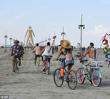 The only way to get around: Burning Man participants bike on the playa during the annual Burning Man event on the Black Rock Desert of Gerlach, Nevada on Monday, prior to the 24 hour rain delay
