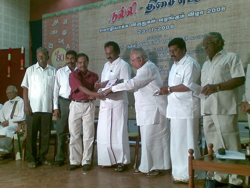 Dr. Raghuram receiving award for best translation (from Malayalam to Tamil)