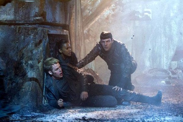 Captain Kirk (Chris Pine), Mr. Spock (Zachary Quinto) and Nyota Uhura (Zoe Saldana) take on a squad of Klingons (off-screen) in STAR TREK INTO DARKNESS.
