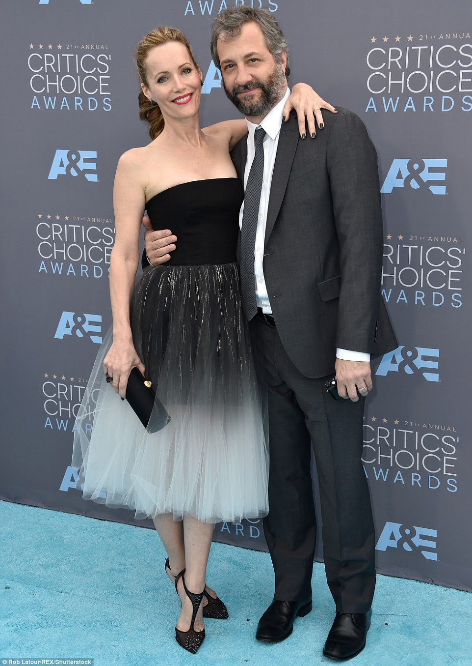 His princess: Judd Apatow was joined by Leslie Mann, who looked fabulous in a black and white frock byMonique Lhuillier