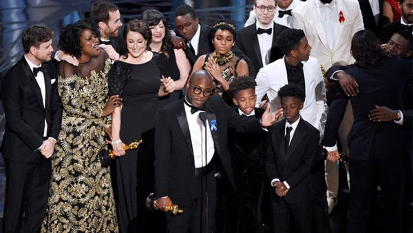 The cast and crew of MOONLIGHT celebrate on stage after winning Best Picture at the 89th Annual Academy Awards...on February 26, 2017.