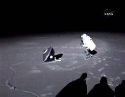 A scientist approaches the Stardust return capsule after it parachuted to the ground around 2:10 AM (Pacific Standard Time) this morning.  The touchdown occurred at the Dugway Proving Ground in Utah.