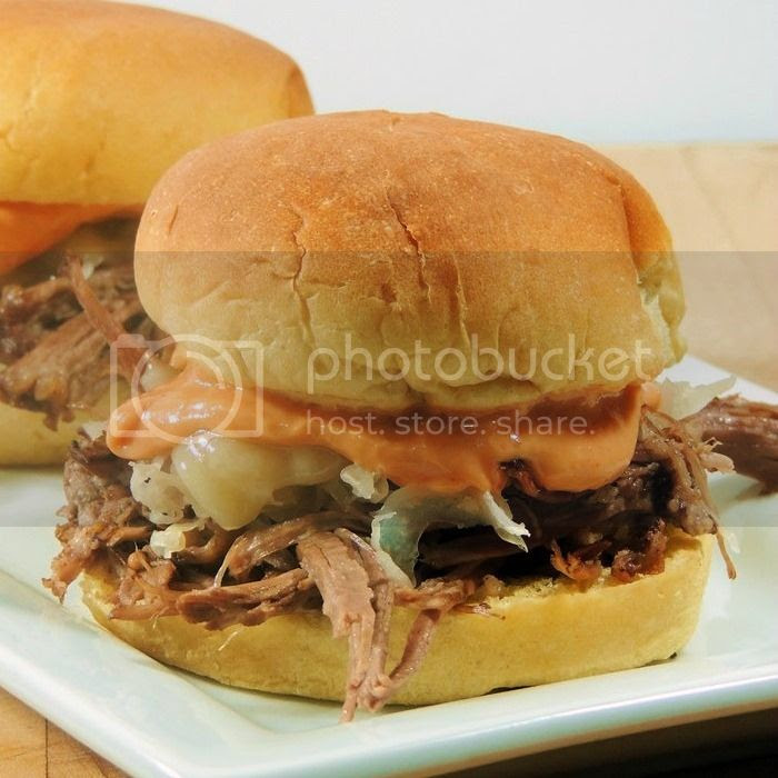Reuben Sliders - Make these tasty little corned beef sliders for your St Patrick's Day festivities. They are cute, tasty, and sure to please your guests! From www.bobbiskozykitchen.com