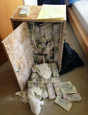 Stash: $8.5million - around £5million - was found hidden in a wooden box in an east London apartment. It was discovered by TV crews from Channel 5 who were making a documentary about bailiffs