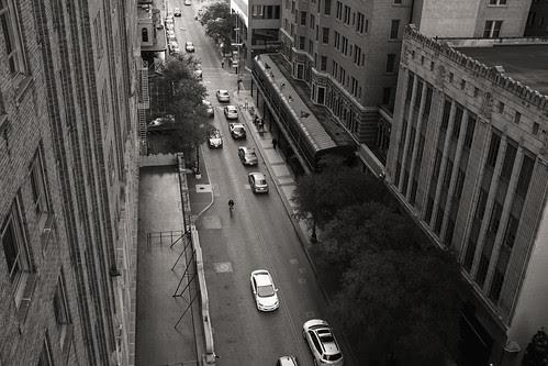 Cyclist on Houston St. by Jesse Acosta