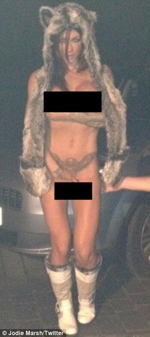 Baring all: Jodie goes naked apart from a furry hat and boots in the shots, which we have censored