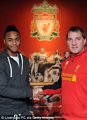 Shake on it: Sterling with Liverpool boss Rodgers