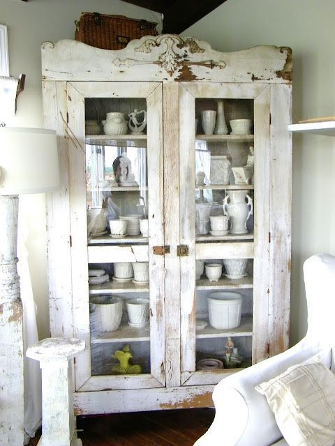 Beautiful old white distressed wood cupboard filled with ironstone collection | Friday Favorites from anderson + grant