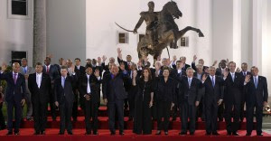 Regional leaders stand under a statue of Simon Bolívar during the CELAC summit in Havana