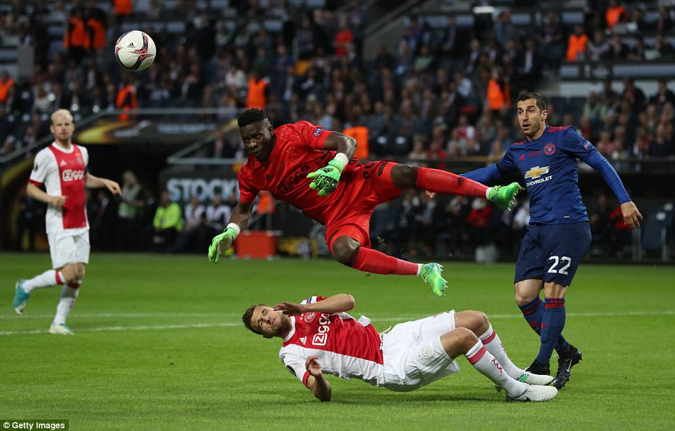 Joel Veltman of Ajax collides with his goallkeeper Onana during the early stages of the Dutch side's clash with United