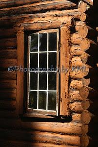 a window on a log cabin