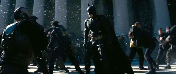 Batman (Christian Bale) gets ready to brawl as Bane approaches in THE DARK KNIGHT RISES.