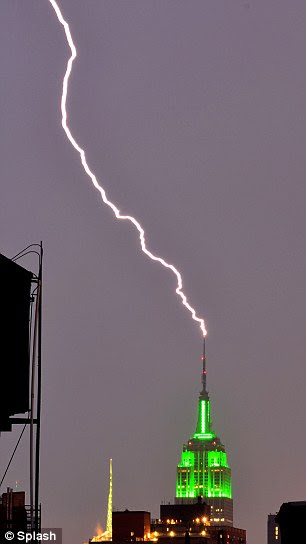 Lightning strikes the Empire State Building in New York City as the heat causes thunderstorms on Thursday night