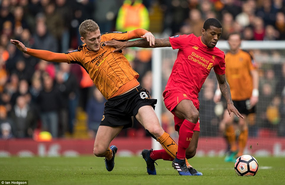 Georginio Wijnaldum holds off Wolves midfielder James Saville during the early stages of the game on Saturday