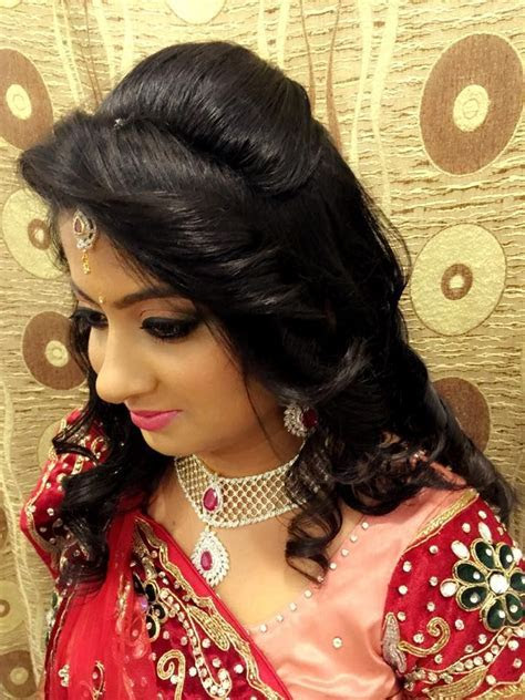 Indian bride's bridal reception hair. Hairstyle by Swank