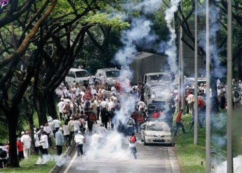 Protesters run away as Malaysian riot police fire tear gas during a protest against using English for mathematics and science teaching in Kuala Lumpur, Malaysia, Saturday, March 7, 2009. AP Photo