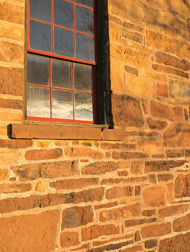 Sunrise reflecting off of windows of Old Stone House at Manassas National Battlefield, Virginia