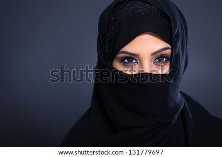 mysterious Arabian woman on black background - stock photo