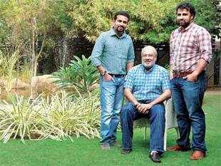 Sanjay Lalbhai (M) with sons Kulin (L) and Punit (R) at the Arvind headquarters in Ahmedabad