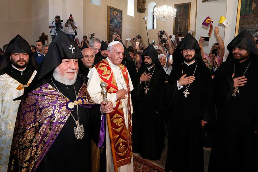 Catholicos Karekin II, patriarch of the Armenian Apostolic Church, and Pope Francis arrive to visit the Armenian Apostolic Cathedral at Etchmiadzin in Vagharshapat, Armenia, June 24.