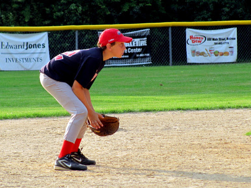 Baseball player in the field relaxed and ready to field any ball hit in his direction