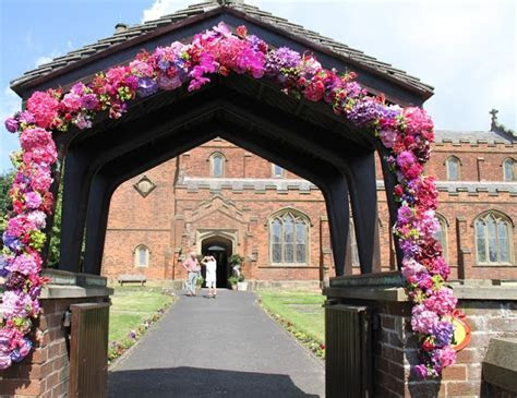 Flower Design Events, Fabu Floral arch on a Lytch Gate