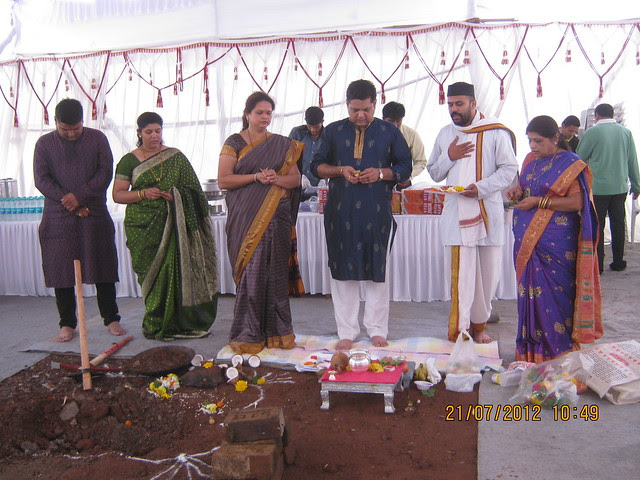 Mrs. & Mr. Nitin Kulkarni, Mrs. & Mr. Sachin Kulkarni performing Bhoomi Poojan of UrbanGram Chakan Pune with their mother
