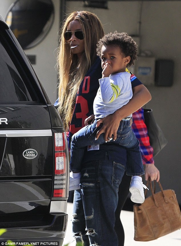 Got some weight to it:As the singer picked up her little boy, her engagement ring was put on prominent display and it looked as though it was so heavy that it was slipping down the pop star's finger
