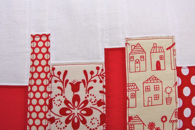 Quilted pillow in reds - detail