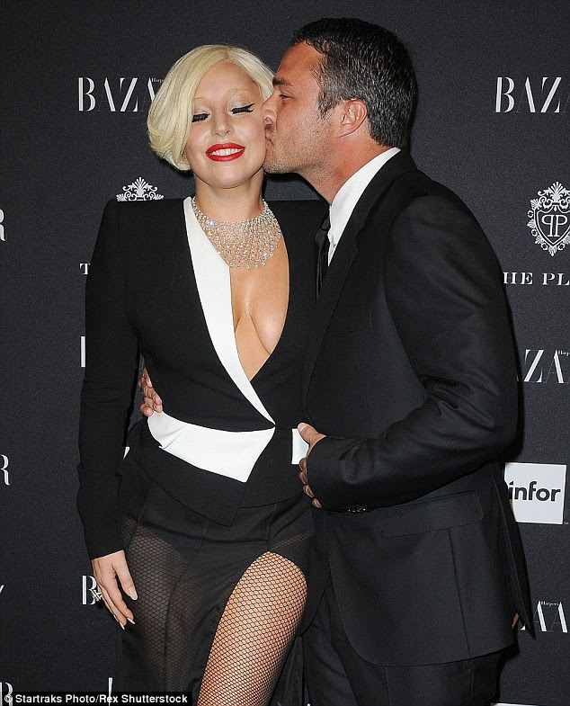 'She's someone who likes to eat well': But don't expect the Italian-American songstress to starve herself before marrying Taylor Kinney (pictured in September)