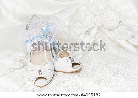 stock photo Bride 39s shoes garter with blue ribbon wedding dress