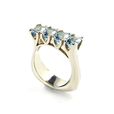 9 carat white gold and aquamarine ring, $2,800, Love and