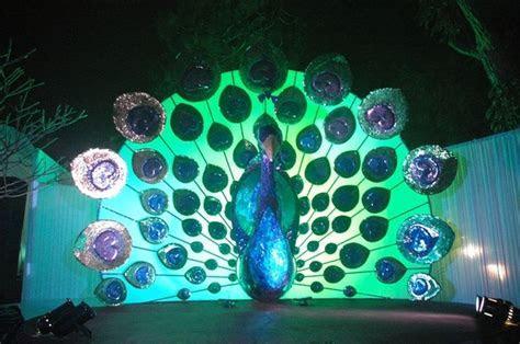 Peacock  themed wedding stage decoration   Gabbi's