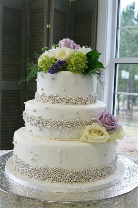 3 tiered white wedding cake with silver fondant pearls and