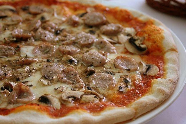 Pizza Rustica - tomato, cheese, Italian pork sausage, and button mushrooms