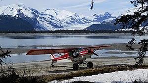 Taku River; a wheeled airplane on the beach