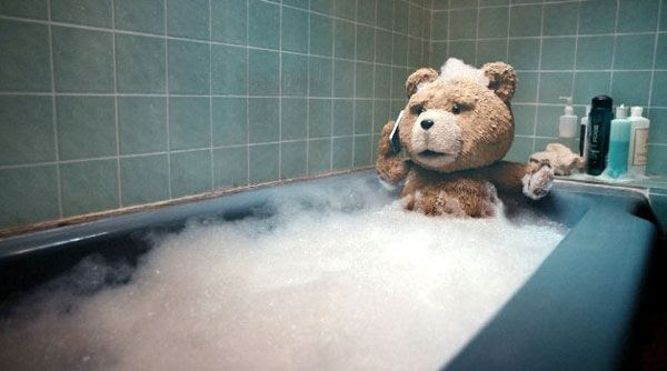Ted chills inside a bathtub at his own apartment in TED.