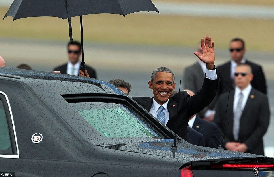 Obama waves after his arrival on Jose Marti Airport in Havana before being driven into the city for a tour of its Old Town district