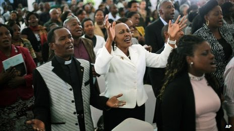 Friends and relatives of Mbugua Mwangi and his fiancee Rosemary Wahito attend their funeral service in Nairobi in Kenya, 27 Friday September 2013