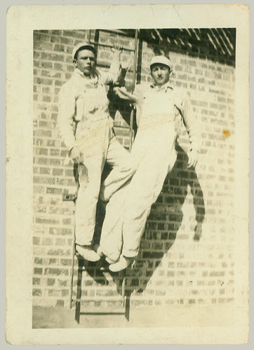 Two guys on a ladder
