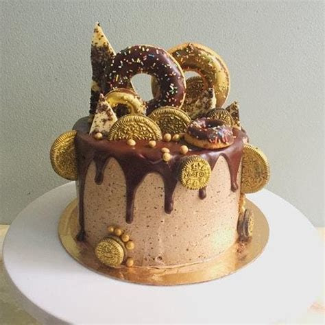 Bespoke doughtnut topped cake with GOLD lustre Oreos