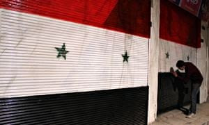 Syrian shops painted in national flag colours