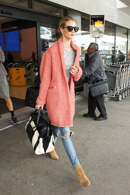 Le Fashion Blog Model Style Airport Look Rosie Huntington Whiteley Bright Pink Coat Grey Tee Ripped Knee Skinny Jeans Tan Suede Ankle Boots Via Popsugar