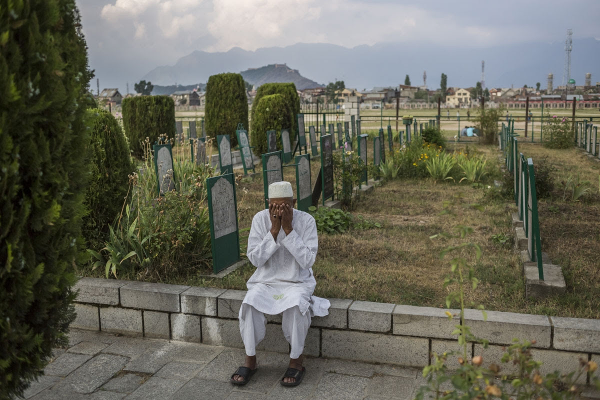 Praying at a cemetery in Srinagar. June, 2016. (AFP / Rebecca Conway)
